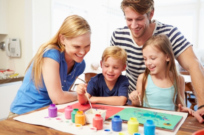 Parents-Painting-Picture-With-Children-At-Home-Dollarphotoclub_70864529-700x466.jpg